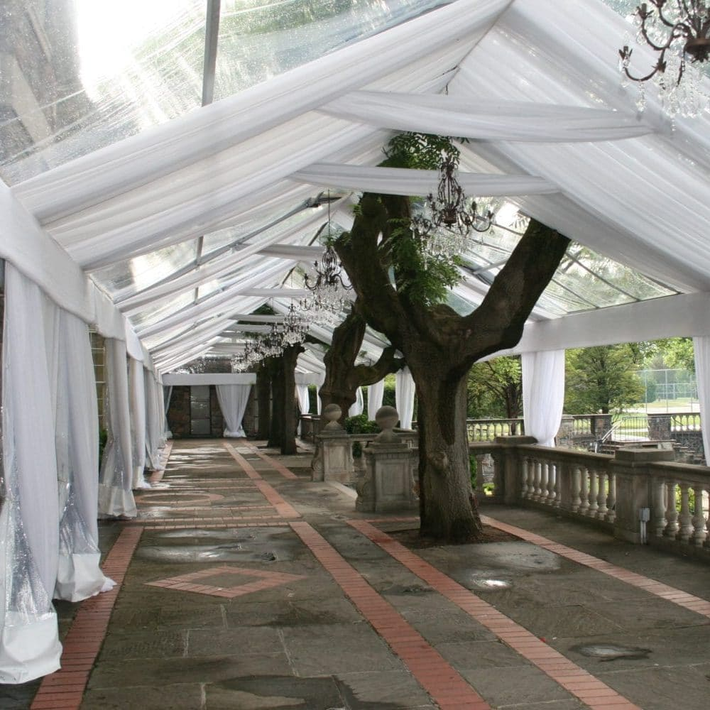 White tent liner and clear tents can create an elegant look of being outdoors while also staying protected and stylish