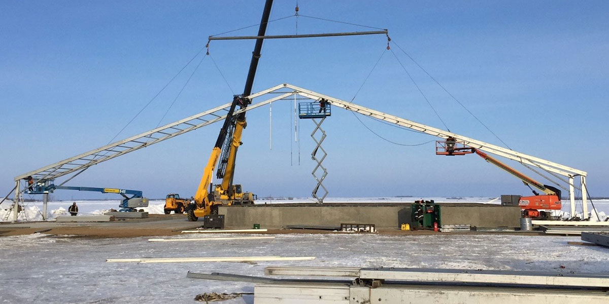 Temporary construction structure going up in winter conditions