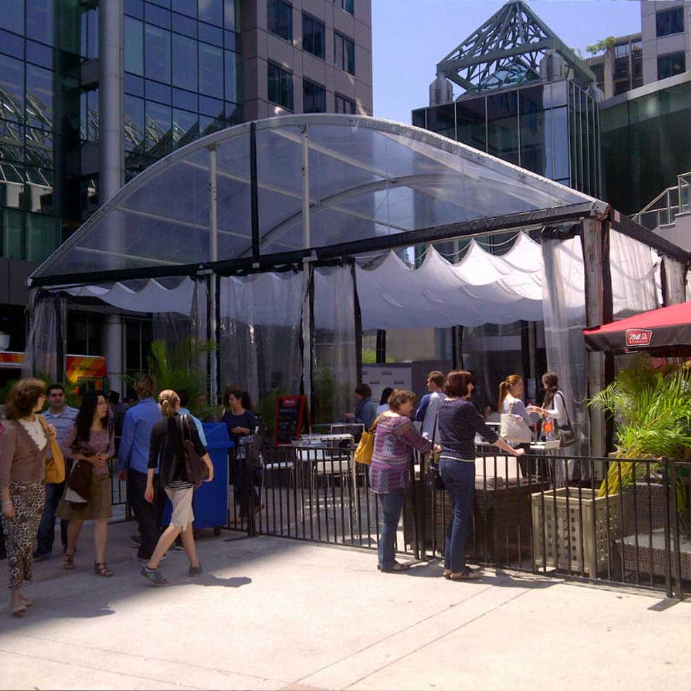 Curve Top Tents help expand existing space and give temporary extra seating where needed