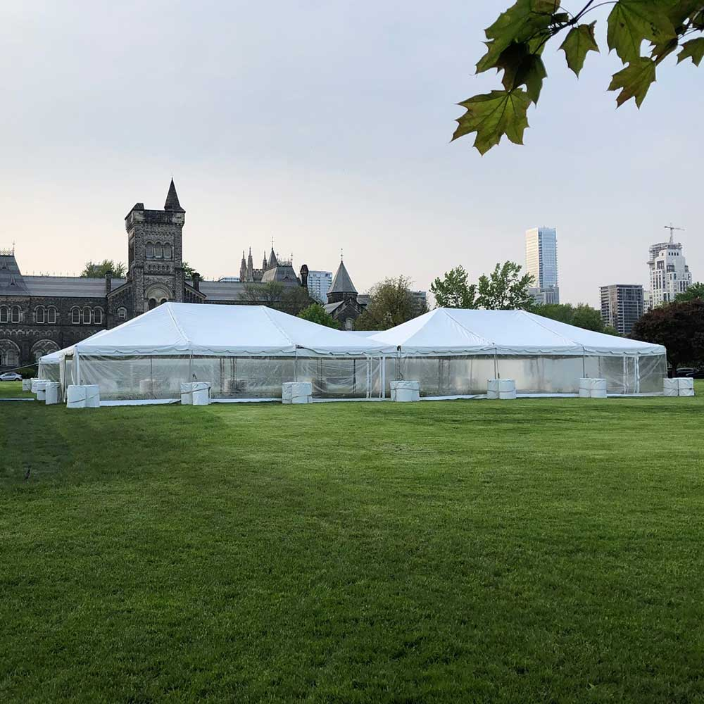 Two large frame tents connected for outdoor event
