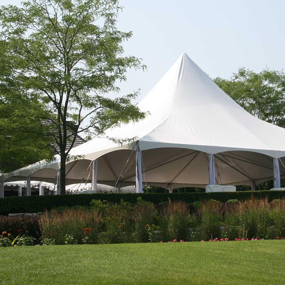 Large frame tent used for backyard wedding