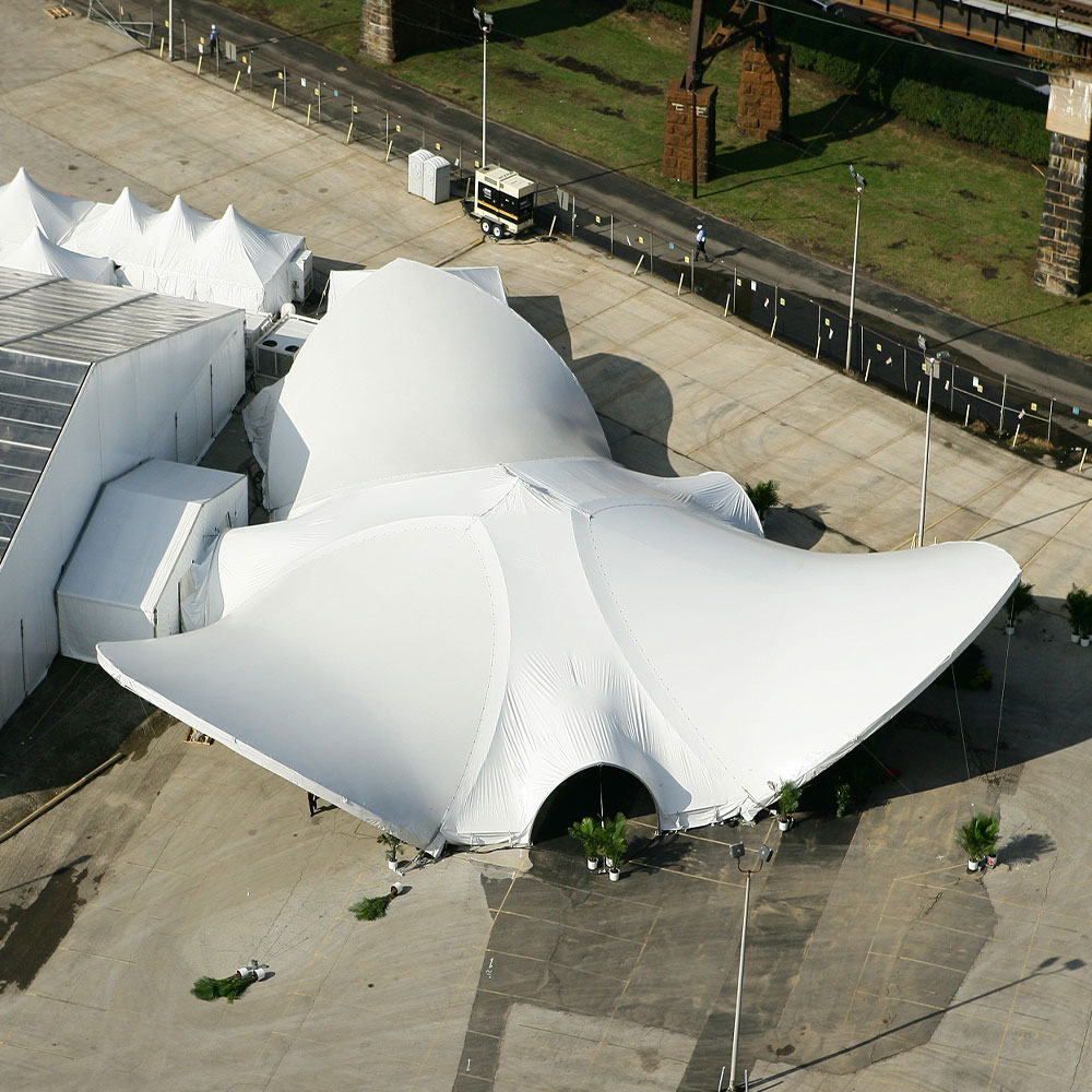 Aerial view of three saddlespan tents connected to create a dramatic event entry