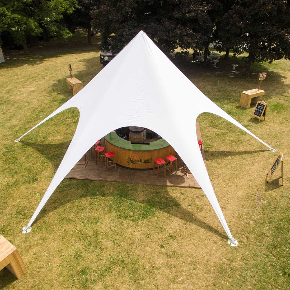Star shade tent used for an outdoor bar